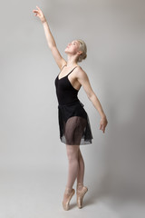 graceful ballerina in studio