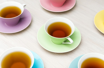 Colorful tea cups background