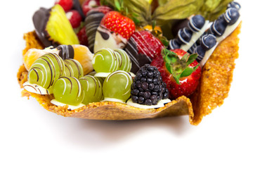 Variety of fresh fruits with decorative chocolate on white background