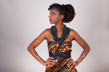 Young beautiful african woman wearing  traditional clothes