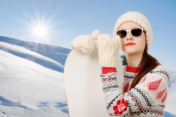 portrait of a happy young girl snowboarding with sunglasses