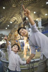 Young father and son in museum of natural history
