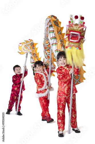 db3cdbe42f Three Chinese children holding Chinese dragon