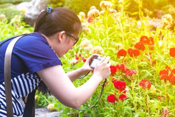 Female photographer with professional digital camera.