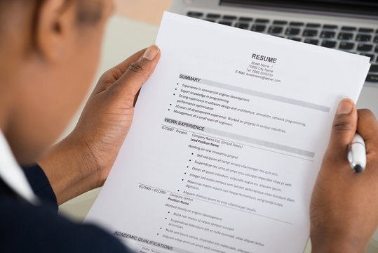 Businesswoman Hand Holding Resume