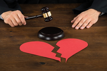Divorce Lawyer With Broken Heart Hitting Gavel