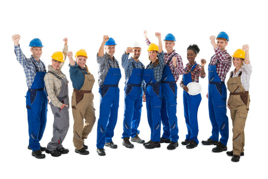 Happy Carpenters Standing With Arms Raised