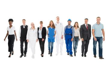 Confident People With Various Occupations Walking In Row