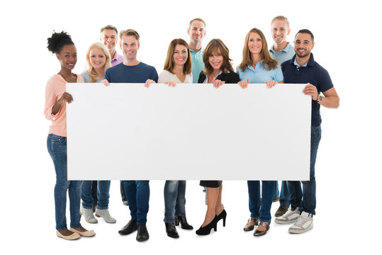 Confident Creative Business Team Holding Blank Billboard