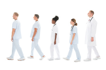 Side View Of Medical Team Walking In Row