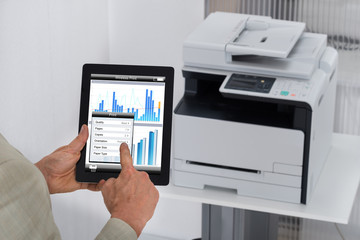 Businessman Giving Print Command On Digital Tablet