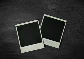 Photo frame of polaroid on black background.