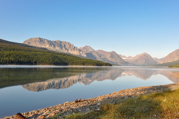 Fototapete - Reflective mountains in Glacier National Park, Montana, USA