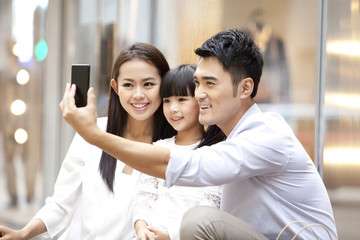 Young family doing self portrait photography in Hong Kong