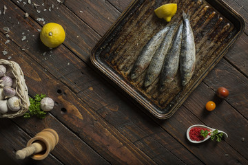 Cooking fish with lemon garlic dill