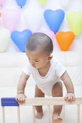 Chinese baby boy and colorful balloons