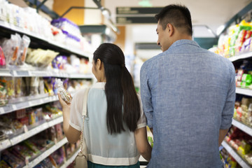 Young couple shopping in supermarket