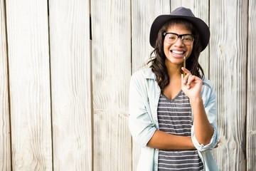 Smiling casual woman posing with glasses and hat