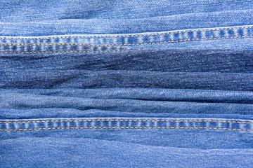 pile of denim jeans select focus