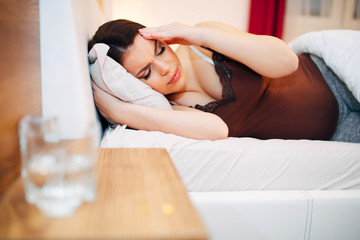 Beautiful pregnant woman struggling with headache