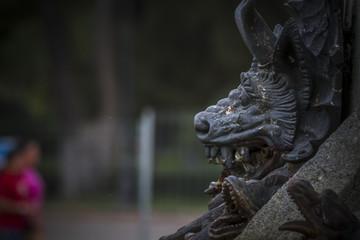 devil figure, bronze sculpture with demonic gargoyles and monste