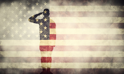 Double exposure of saluting soldier on USA grunge flag. Patriotic design
