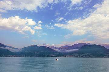 Como lake landscape.  A view of the  fishing boat, Varenna on Como lake in Italy, Alps, Europe.