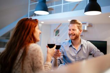 Beautiful couple toasting with wine