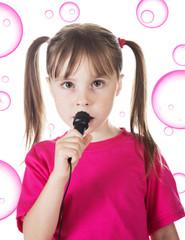 Little girl sings.
