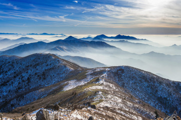 Wall Mural - Winter landscape and foggy in Deogyusan mountains, South Korea.