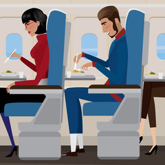 People have lunch on the plane - in-flight meal concept