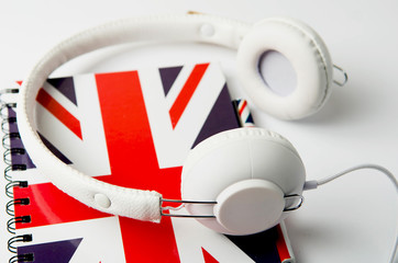 learn English concept with british flag and headphones. English school