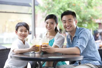 Family enjoying cold drink together