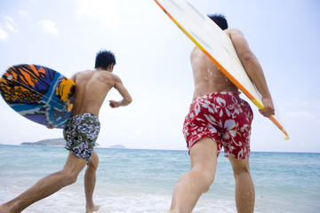 Friends ready to surf