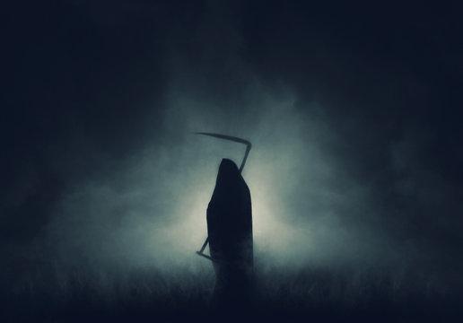 Grim reaper, the death itself, scary horror shot of Grim Reaper in fog holding scythe.