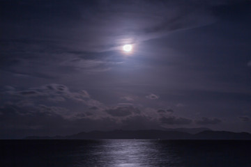Full moon with clouds and sky over the sea