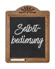 Kreidetafel mit der Beschriftung Selbstbedienung