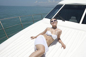Young Woman Relaxing on a Yacht