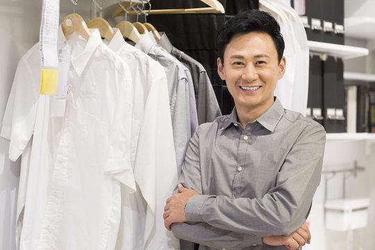 Happy man in front of  wardrobe