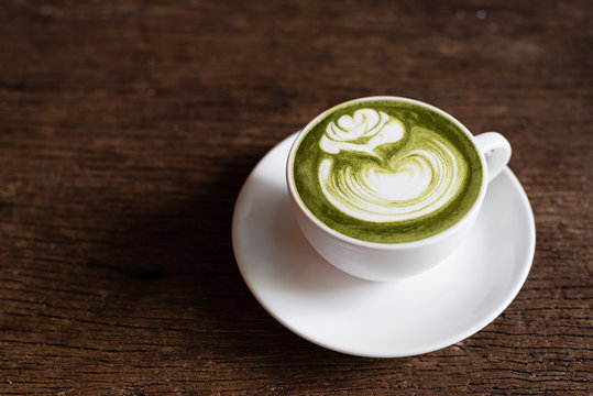 matcha green tea latte with latte art in rose pattern