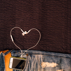 Texture background of jeans , belt detail with mobilephone and e