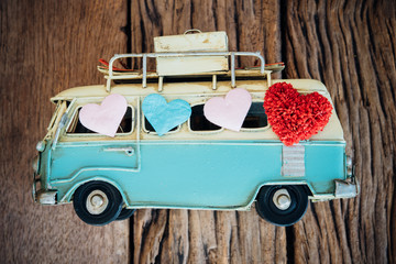 Valentines day background with heart on toy van over wood  backg