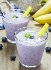 Fresh smoothie with blueberry, banana, oats, almond milk and yogurt