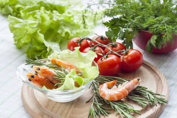 Tiger Prawn Shrimps with green lettuce and rosemary. Prawn Shrimps with green lettuce and rosemary in glass plate.