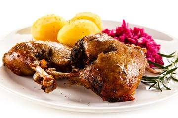 Roast duck legs and vegetables