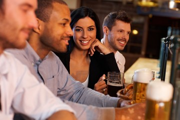 Young woman with friends in pub
