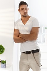 Young man standing arms crossed