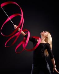 Artistic photo of rhytmic gymnast with ribbon