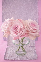 beautiful pink rose flowers in a vase on a vintage background