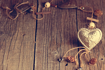 Silver heart on a wooden table with decorations. Valentines day. Love. Gift. Ilustration on a natural background.